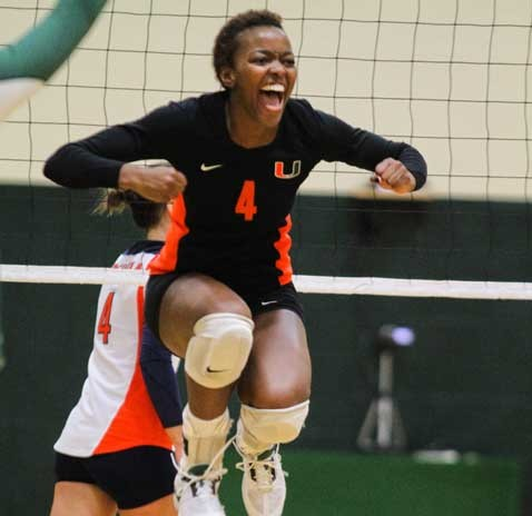 VERTICAL JUMP: Collecting eight starts for the Hurricanes last year, senior middle-blocker Arielle Cooke celebrates with height after placing a kill against Clemson University. Volleyball is one of the 15 University of Miami division one sports teams that plays in the Atlantic Coast Conference.