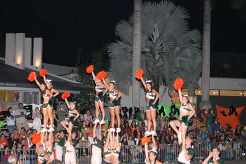 "C-A-N-E-S....CANES:The University of Miami cheerleaders rally alumni and students during the the 2009 homecoming parade. This year's parade takes place on Nov. 5 at 7 p.m. on Stanford Drive and is based around the game of Monopoly to represent the theme ""Are you game?"""