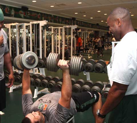 PUMPING METAL WITH SWASEY: Swasey advises an offensive linemen as he works out in the high-tech Hecht Athletic Center.