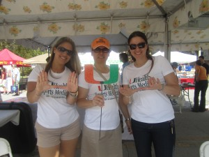 Miller school students throw up the U at the Farmer's Market.