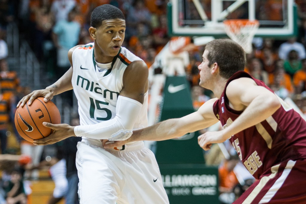 CORAL GABLES, FLA. -- Feb. 5, 2013: Junior guard Rion Brown keeps Boston College defender at bay. (Photo by Zach Beeker)
