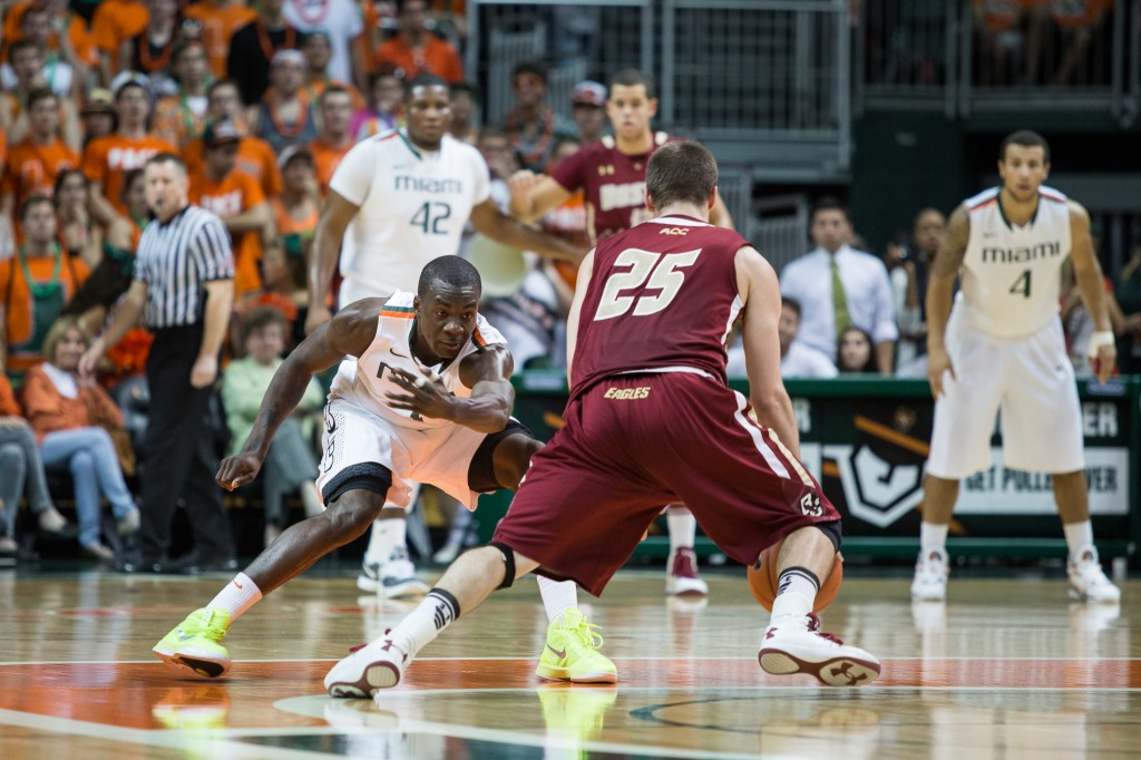 CORAL GABLES, FLA. -- Feb. 5, 2013: Senior guard Durand Scott defends Boston College's Joe Rahon. (Photo by Zach Beeker)