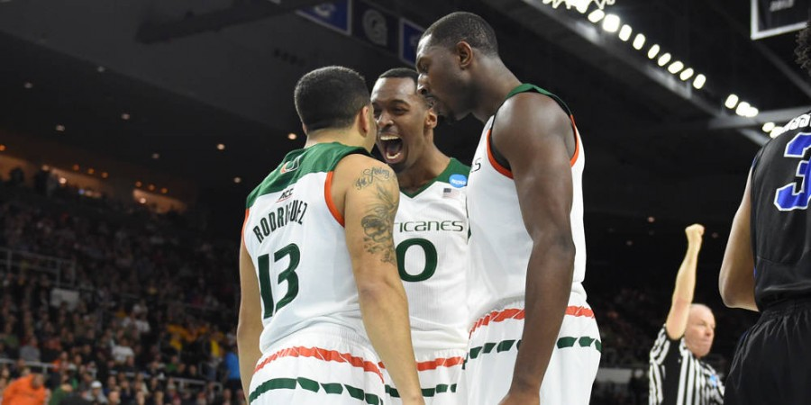 Angel Rodriguez, Sheldon McClellan, and Davon Reed celebrate during their second-round win in the NCAA Tournament / Hurricanesports