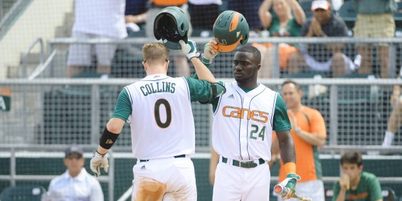 Zack Collins (0) and Jacob Heyward (24) tip the cap to each other early on in the 'Canes 6-4 victory Sunday / Hurricanesports