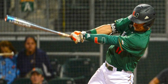 Miami first-baseman Christopher Barr swings in a 7-3 'Canes victory / Hurricanesports