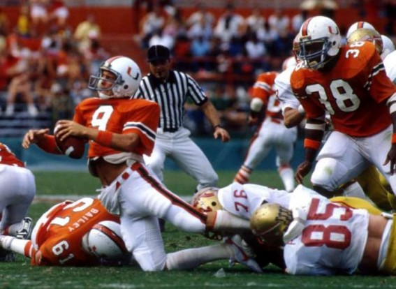 Current Miami head coach, and former quarterback, Mark Richt is sacked in a game against Florida State while wearing the original home uniform. (metrojacksonville.com)