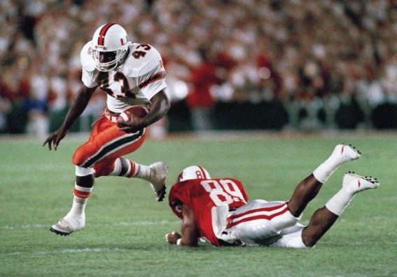 Cleveland Gary runs against Nebraska in the 1989 Orange Bowl, wearing the original Miami away uniform. (Sun-Sentinel)