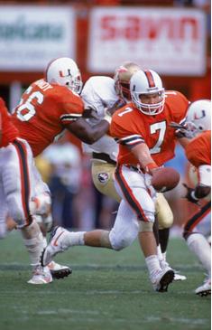Miami quarterback Craig Erickson hands the ball off against Florida State in 1990.