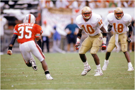 Miami tailback Darryl Spencer looks for space against Florida State in 1992.