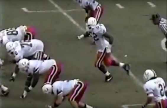 Miami linebacker Ray Lewis tries to time the snap-count against Florida State in 1993.