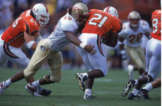 Miami runningback James Jackson tries to break a tackle against Florida State in 2000.