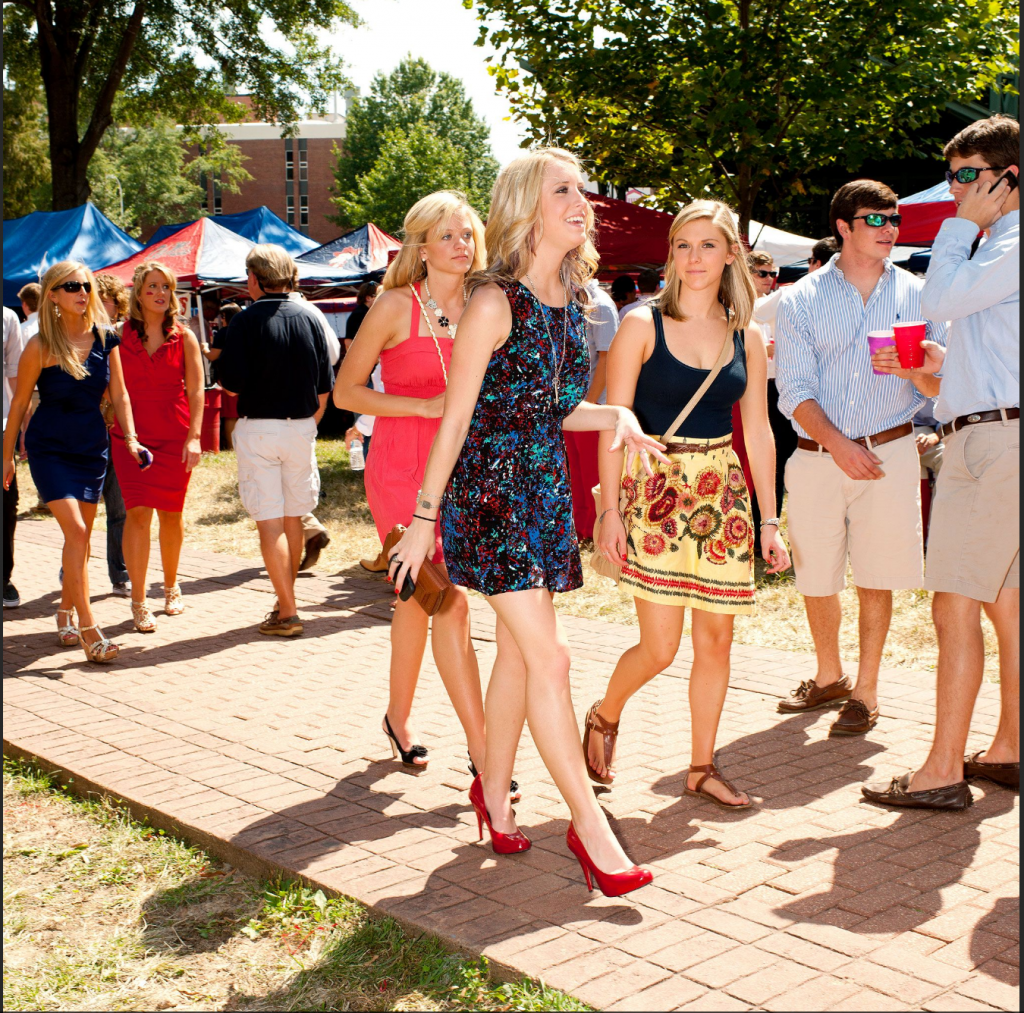 A regular sighting at an SEC tailgate, students dress up in button downs and high heels as seen here at an Ole Miss tailgate. There is no way a University of Miami game day can handle heels and khaki shorts. Source: ESPN.com.