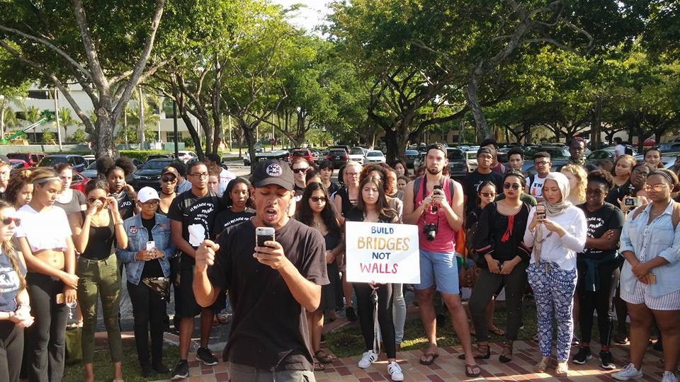 A peaceful protest against President-elect Trump was held on campus and featured chants, signs and spoken word. Source: Elizabeth Bocanegra.