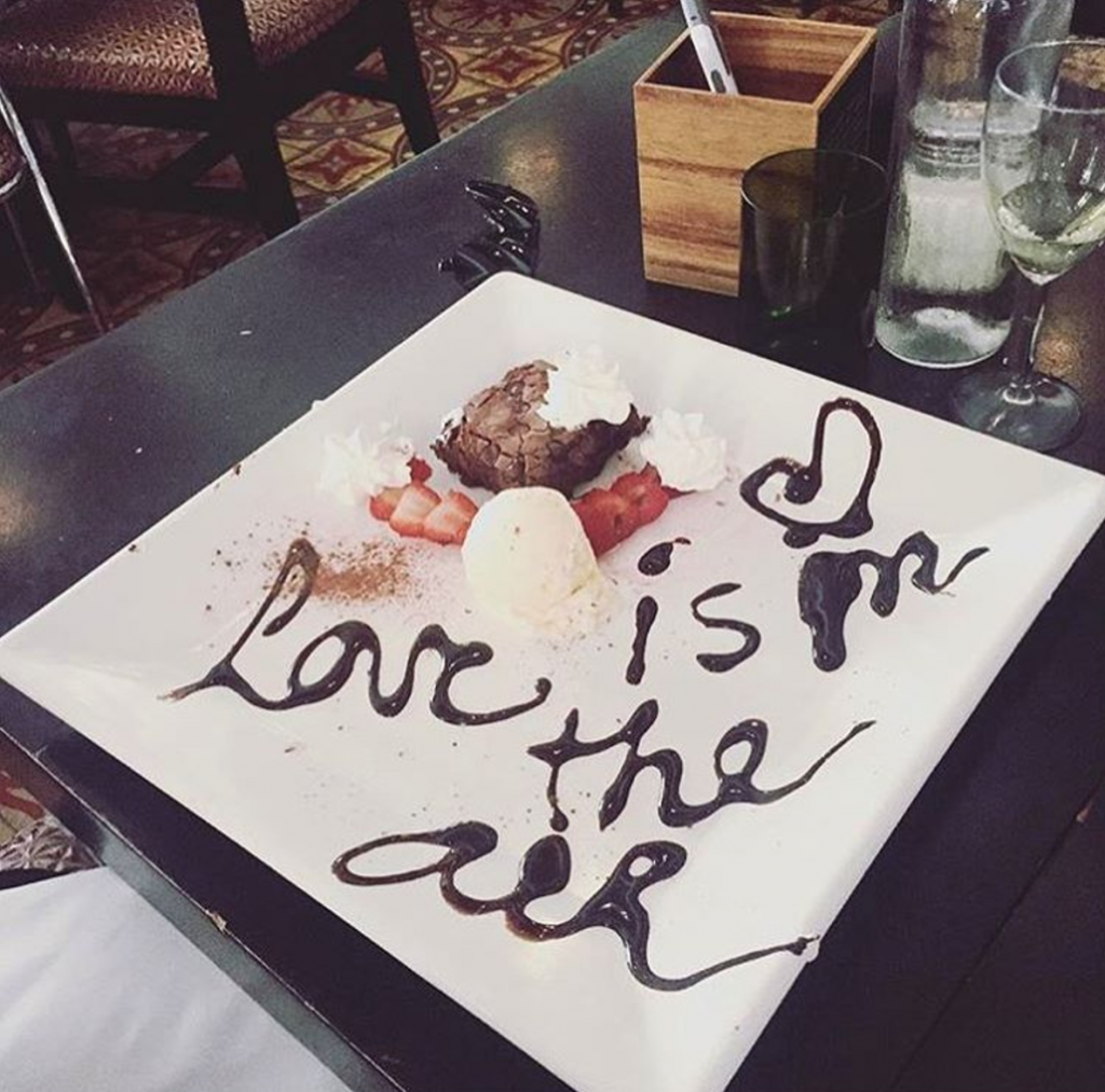 Love is Blind features a warm atmosphere with delicious and unique meals, such as desserts with phrases on them. Source: Instagram, @loveisblindmiami.