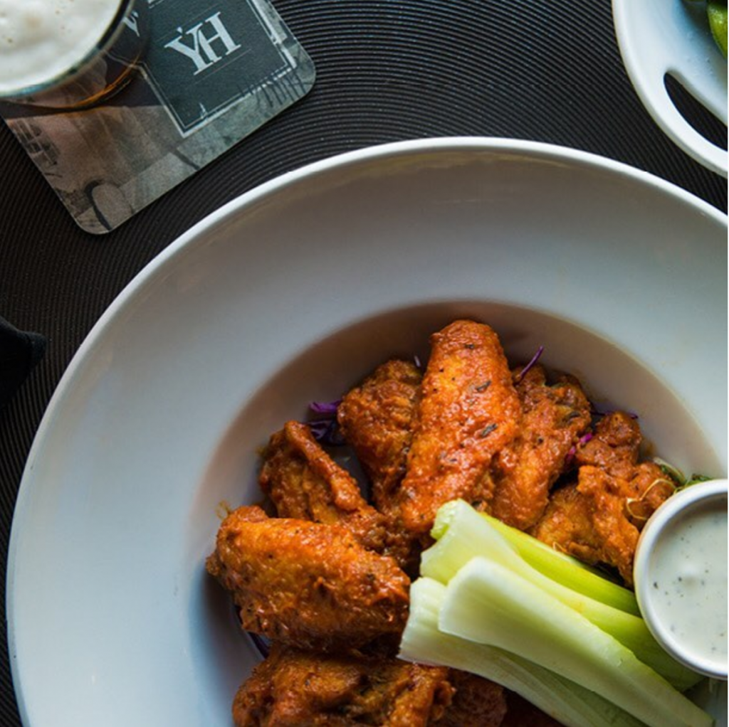 Wings are just one of the many options available at Yardhouse. Order flatbreads, burgers or fried onion rings to go with that football game on TV. Source: Instagram, @yardhouse.