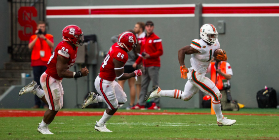 Miami's Mark Walton separates himself from the NC State pursuit Saturday in Raleigh, N.C. (hurricanesports)