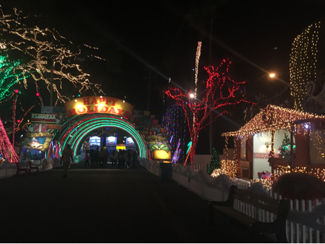 the entrance to santas enchanted forest will have you looking forward to the holiday season everything is covered in lights and holiday music plays - Enchanted Forest Christmas Lights