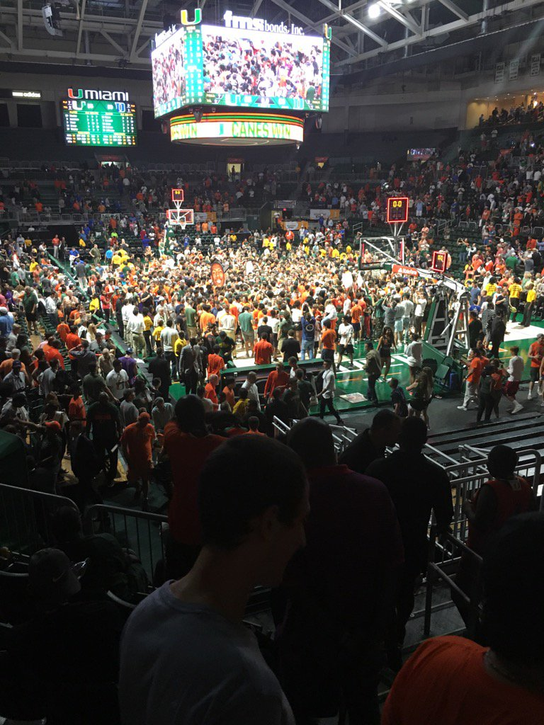 After the University of Miami basketball team defeated Duke, students rushed the court to celebrate with their student-athletes. Source: Twitter, @MarkRicht.