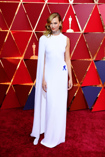 Karlie Kloss wearing a Stella McCartney gown and a blue A.C.L.U. ribbon. Source: Refinery 29.
