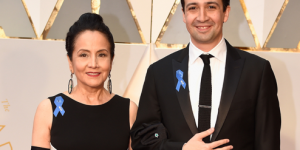 Lin-Manuel Miranda accompanied by his mother on the Oscars Red Carpet. Both wore A.C.L.U. ribbons to support the group. Source: E!