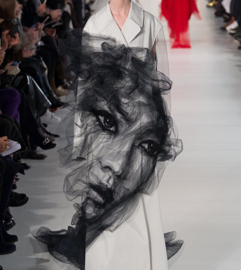 Model walking in the Maison Margiela Haute Couture Fashion Week Show SS17. This face was perhaps the most seen over social media when the show first occurred. Source: Vogue.
