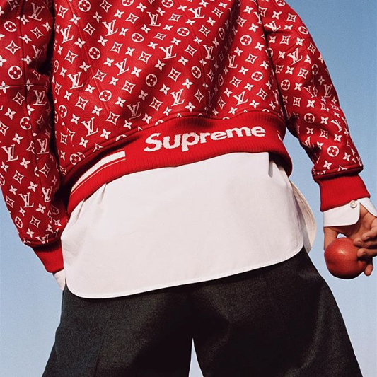 Louis Vuitton X Supreme combined street style and luxury lifestyle. This bomber jacket was one of the signature pieces from the collaboration. Source: HIGHSNOBEITY.
